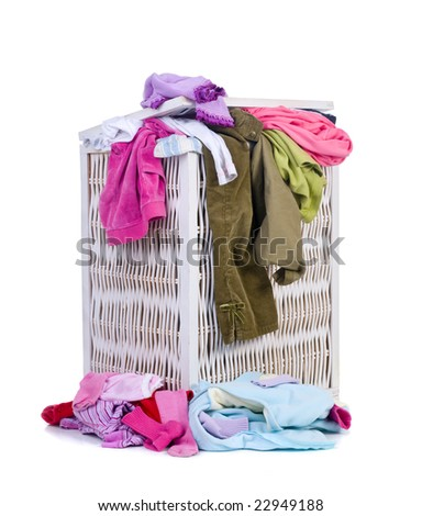 A pile of dirty laundry. Children's clothes never end. Isolated on white - stock photo