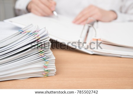 A pile of documents with the man in the document