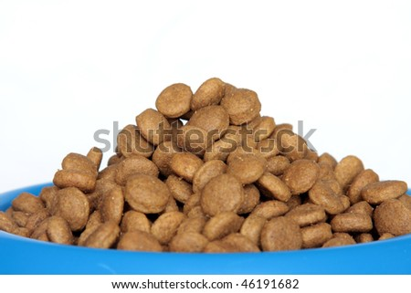 A pile of dog food in a blue bowl.