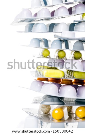 a pile of drugs before white background with copy space - stock photo