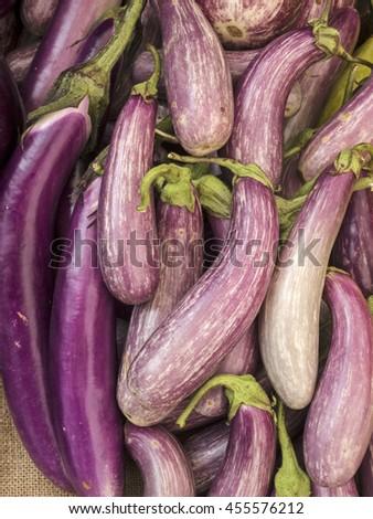 A pile of eggplants at local farm market. - stock photo