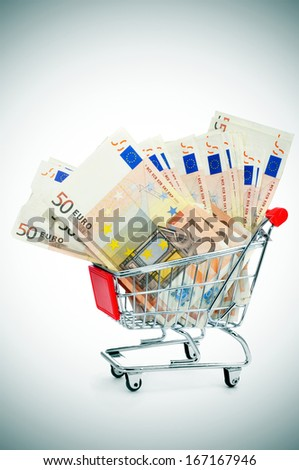 a pile of euro banknotes in a shopping cart - stock photo