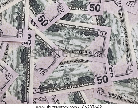 A Pile of Fifty Dollar Bills as a Money Background - stock photo
