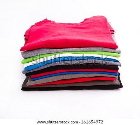 A pile of folded T shirts   - stock photo