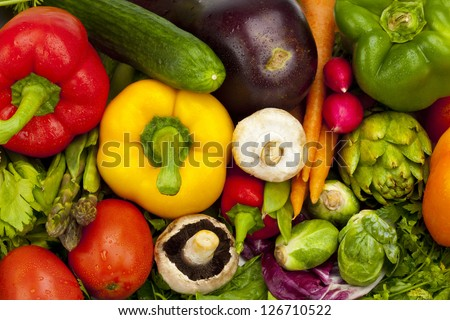 A pile of fresh and crisp summer vegetables. - stock photo