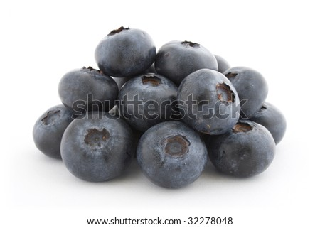 A pile of fresh blueberries isolated on white background with shadow. - stock photo