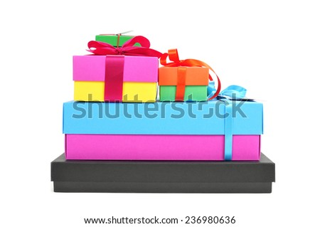 a pile of gift boxes of different sizes and colors tied with ribbon of different colors on a white background - stock photo