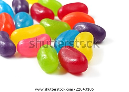 A pile of jellybeans, on a white surface. - stock photo