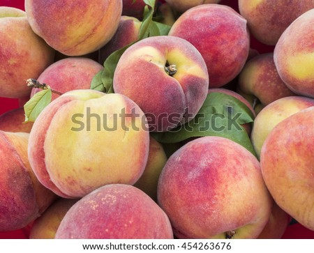 A pile of just picked fresh peaches. - stock photo