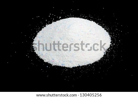 A pile of laundry detergent against a black background - stock photo