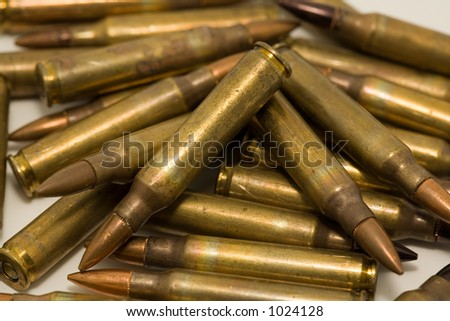 A pile of M-16 5.56mm cartridges - stock photo