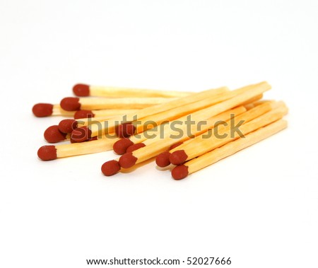a pile of matches isolated on white background - stock photo