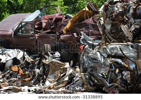 A pile of metal and cars for recycling