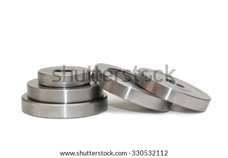 A pile of metal discs on a white background