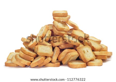 a pile of mini toasts on a white background