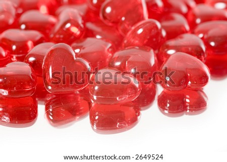 A pile of miniature red glass hearts