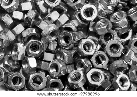 A pile of nuts in black and white - stock photo