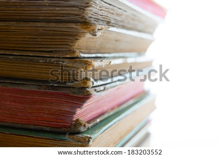 a pile of old books, close up - stock photo