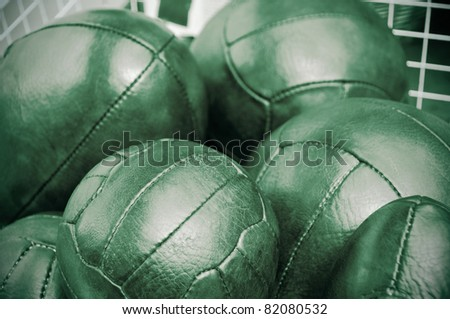 a pile of old leather balls on an antique market - stock photo