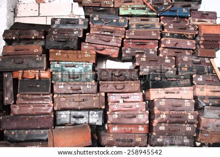 a pile of old vintage suitcases - stock photo