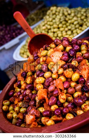 A pile of olives on one of the stalls on the market of one of the medinas, Morocco - stock photo