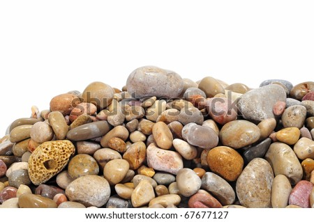a pile of pebbles isolated on a white background - stock photo