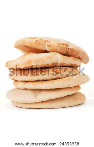 A pile of pita bread on a white background. - stock photo
