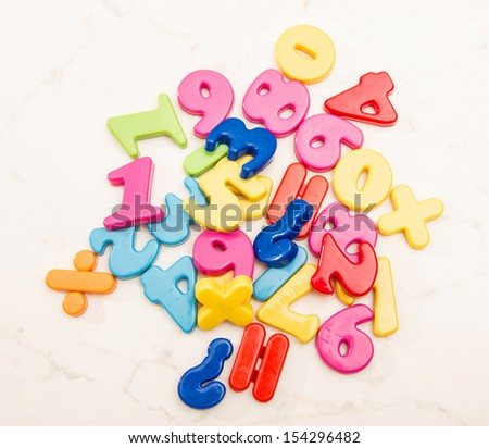 A pile of plastic numbers  - stock photo