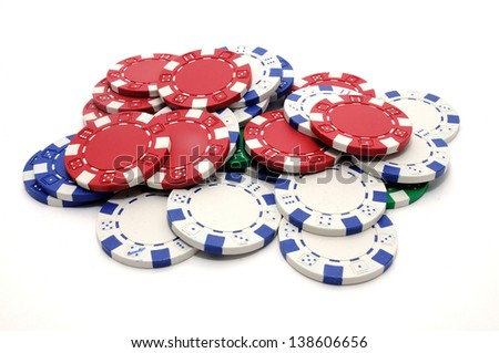 A pile of poker chips, or Casino tokens, isolated on white background. Are small discs used in lieu of currency in casinos, Also widely used as play money in casual or tournament games.