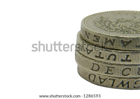 A pile of pound coins with copy space