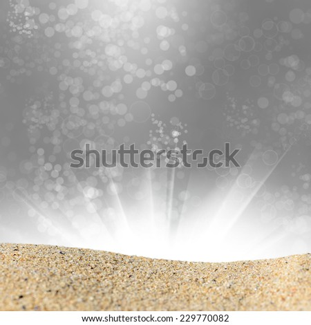 A pile of sand on a beach against the abstract bokeh background. Ready for product display montage - stock photo