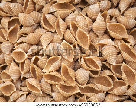 A pile of shell pasta at local market. - stock photo