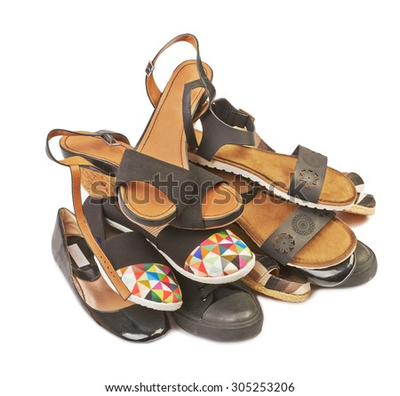 A pile of shoes for men and women on a white background - stock photo