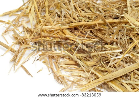 a pile of straw on a white background - stock photo