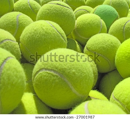 A pile of tennis balls. - stock photo