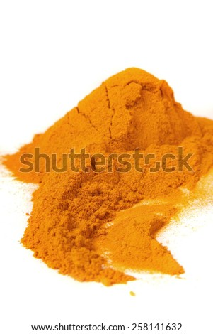 A pile of the colorful spice, ground turmeric or curcumin on a white background