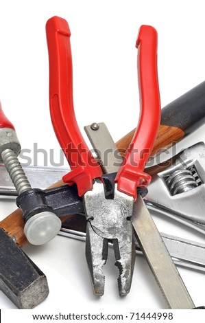 a pile of tools, as a hammer or pliers, isolated on a white background - stock photo