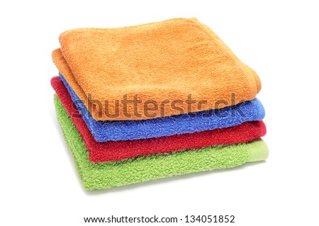 a pile of towels of different colors on a white background