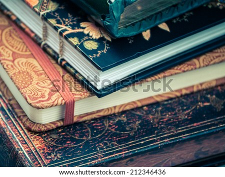 a pile of various beautiful journals and diaries - stock photo