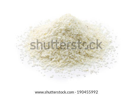 a pile of white corn grits, southern food - stock photo