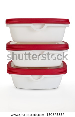 a pile of White plastic container with red lids - stock photo
