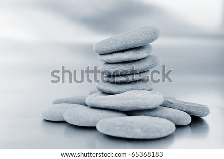 a pile of zen stones in black and white