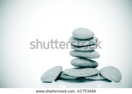 a pile of zen stones on a white background with vignetting