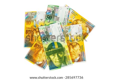 A pile Swiss Franc currency banknotes isolated on white background