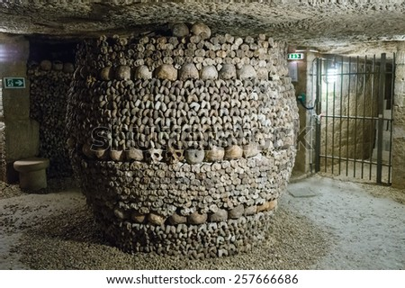 A pillar decorated by skull and bones in the Catacomb of Paris, France - stock photo