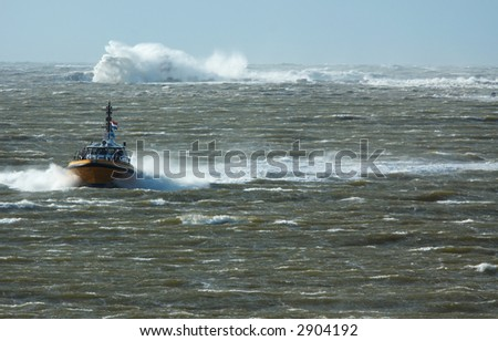 a pilot boat in a storm
