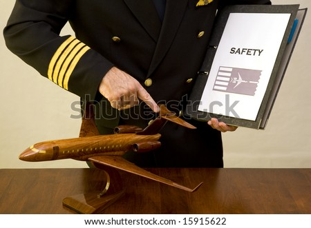 A Pilot facilitating a safety instruction class using a wooden plane and safety file - stock photo