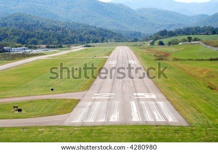 A pilot's view coming in for a landing. - stock photo