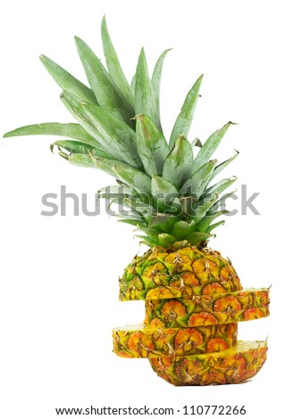 a pineapple sliced and stacked upright - stock photo