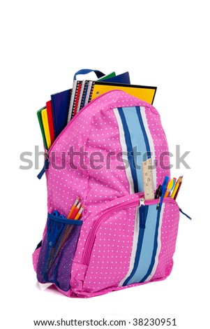 A pink backpack with school supplies on white background - stock photo